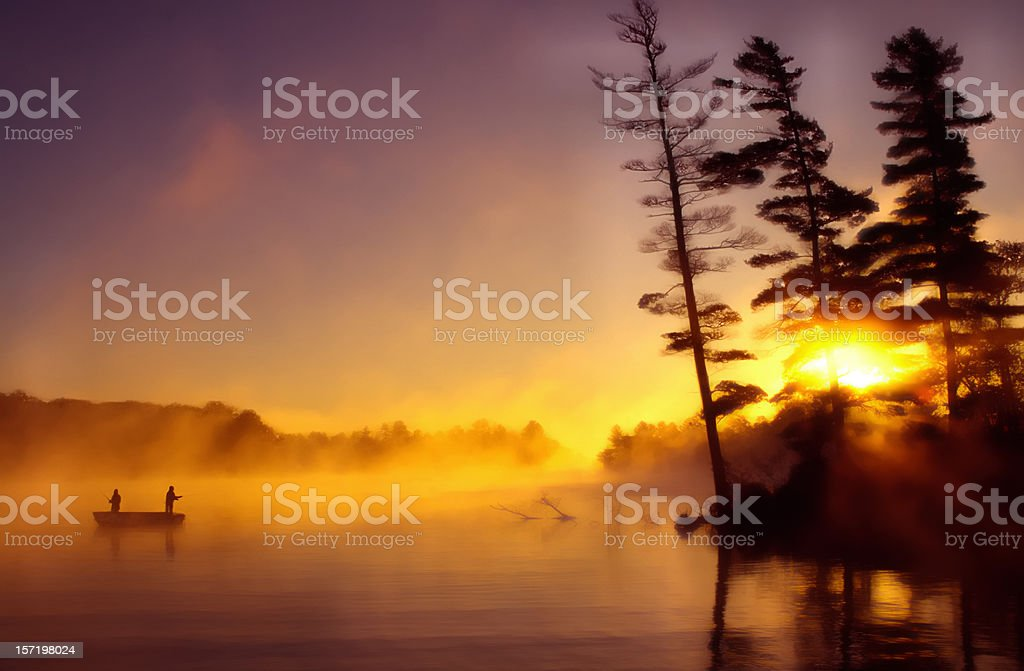 Fishermen in the early dawn royalty-free stock photo
