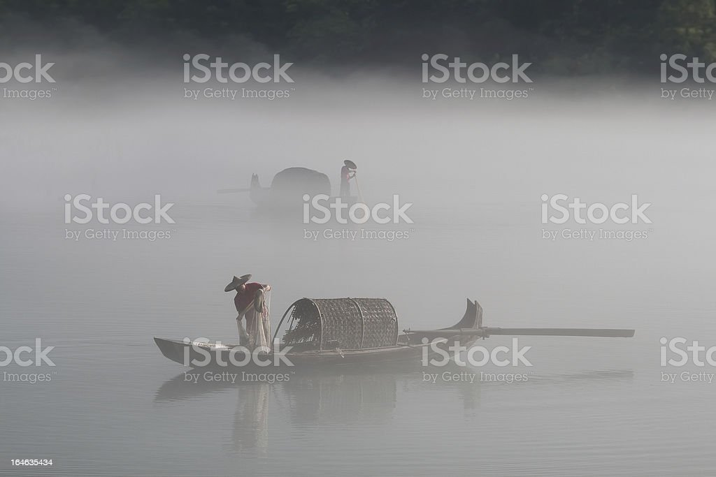fishermen in the fog preparing to fish royalty-free stock photo