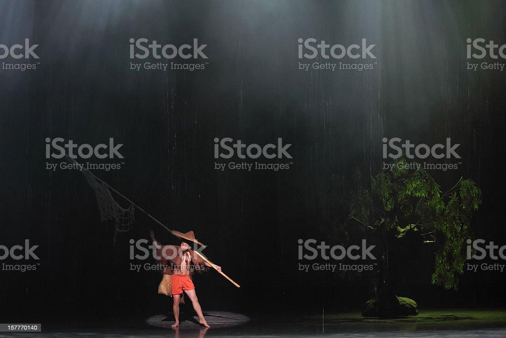 Fishermen in the rain stock photo