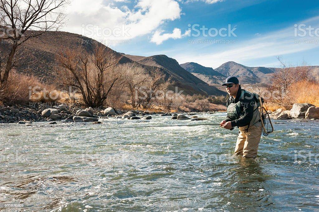 Fishermen In The River stock photo