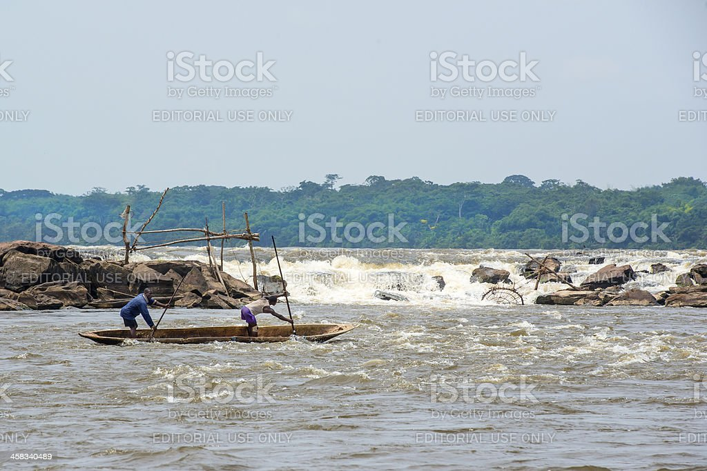 Fishermen in their canoe at the Wagenia Falls, Congo River royalty-free stock photo