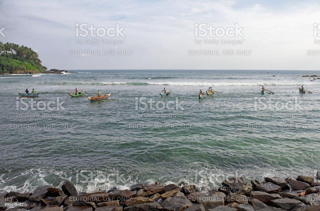 Fishermen in Weligama, Sri Lanka stock photo