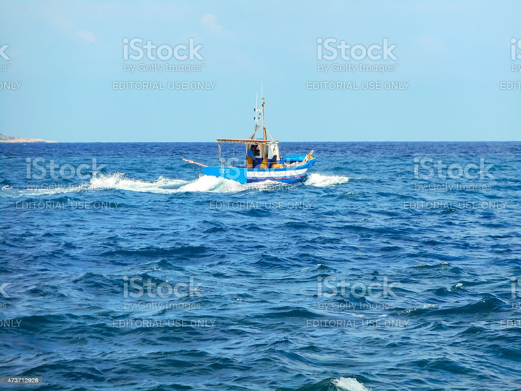 Fishermen on a boat out to fish in the ocean stock photo