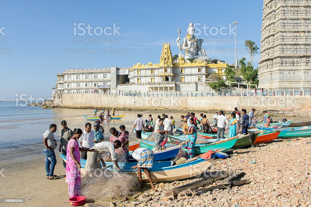 Fishermen on beach, Murudeshwar, Karnataka, India stock photo