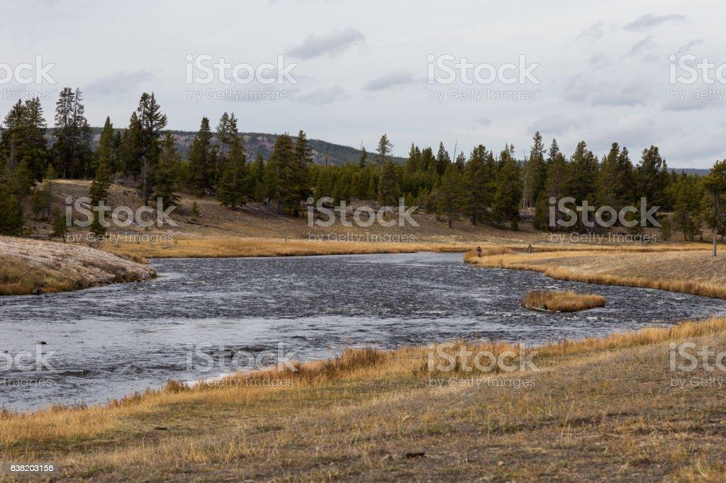 Fishermen on Firehole River stock photo