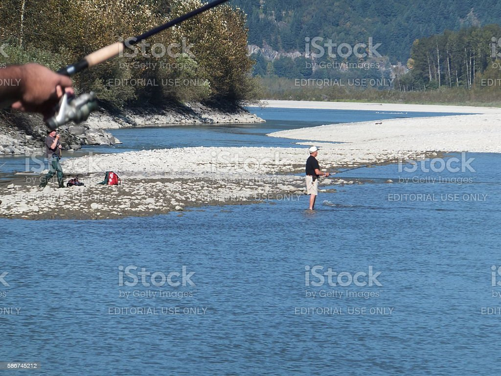 Fishermen on Fraser River during salmon season stock photo
