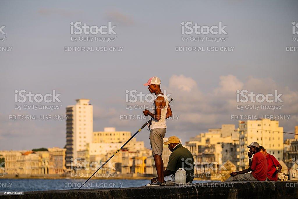 Fishermen on Malecon stock photo