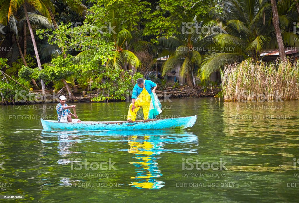Fishermen on New River, Belize stock photo