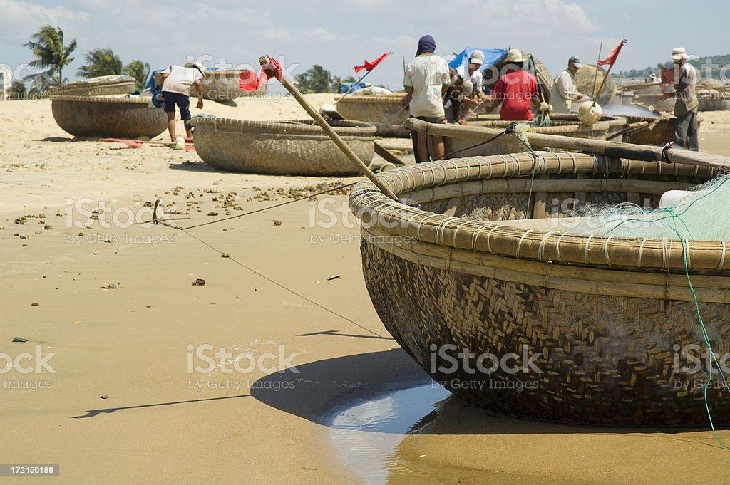 Fishermen On The Beach In Mui Ne, Vietnam royalty-free stock photo
