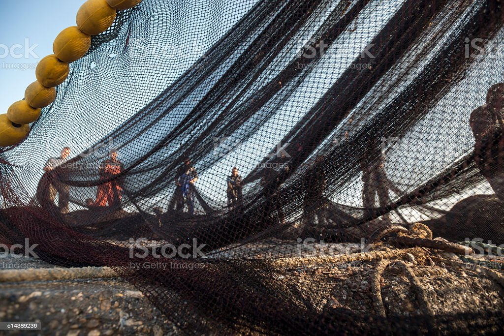 Fishermen on the fishing boat stock photo