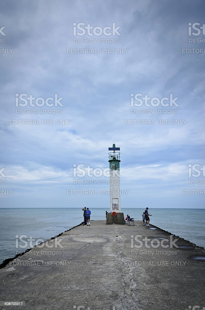fishermen on the lighthouse pier, Grand Bend, Ontario, Canada royalty-free stock photo
