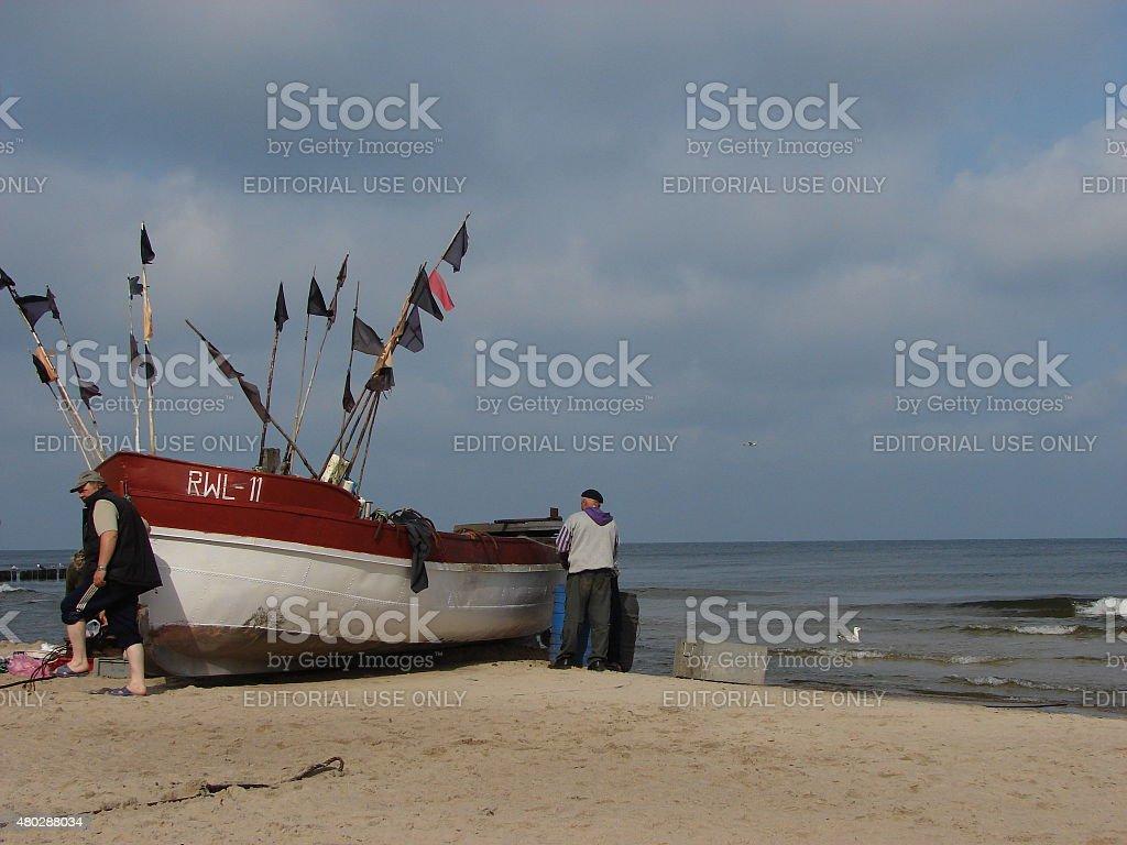 Fishermen on the shore of Baltic Sea stock photo