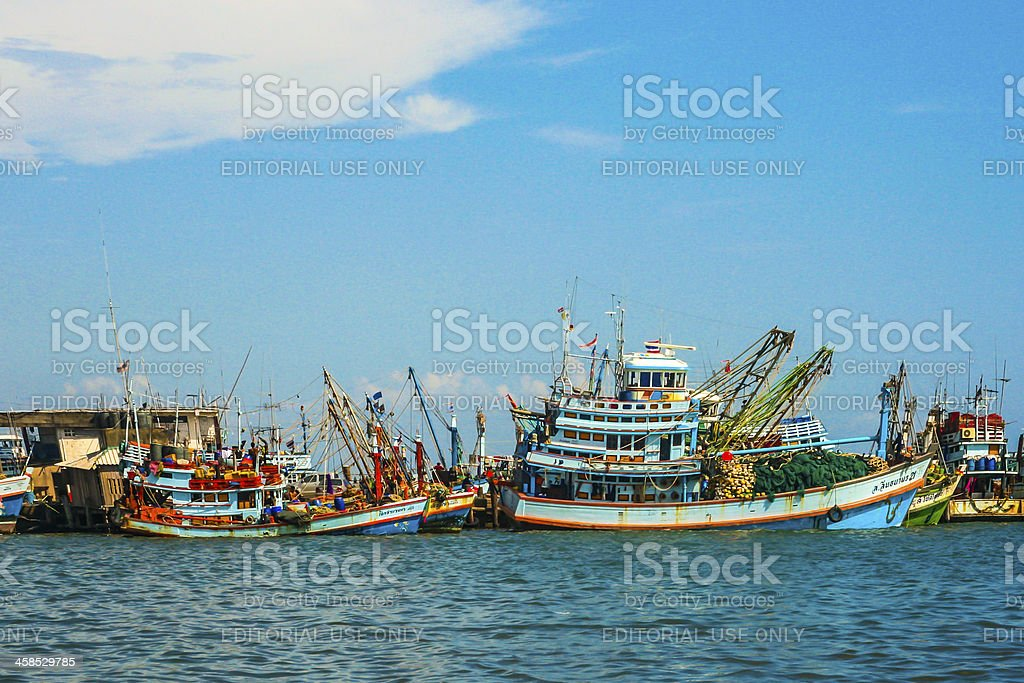 Fishermen prepare the boat for  daily catch royalty-free stock photo