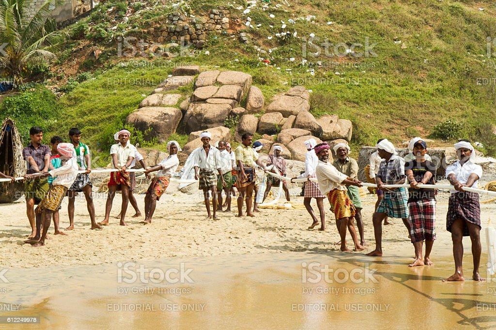 Fishermen pulling a fishing net from the Arabian Sea stock photo