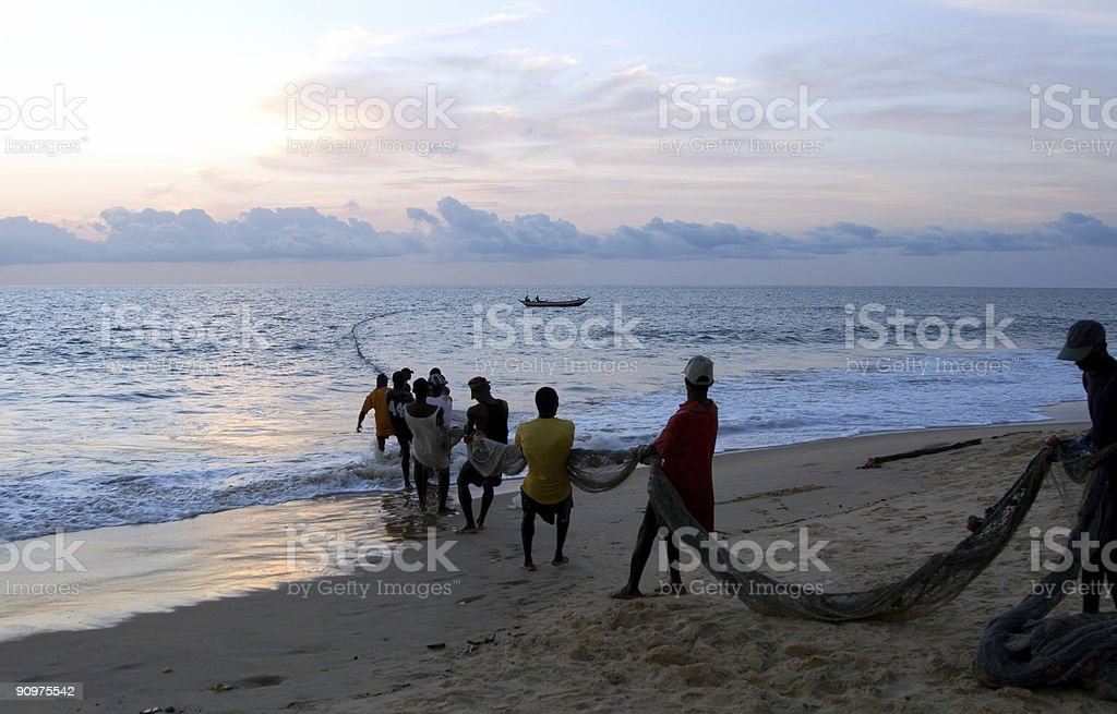 Fishermen pulling a trawl stock photo