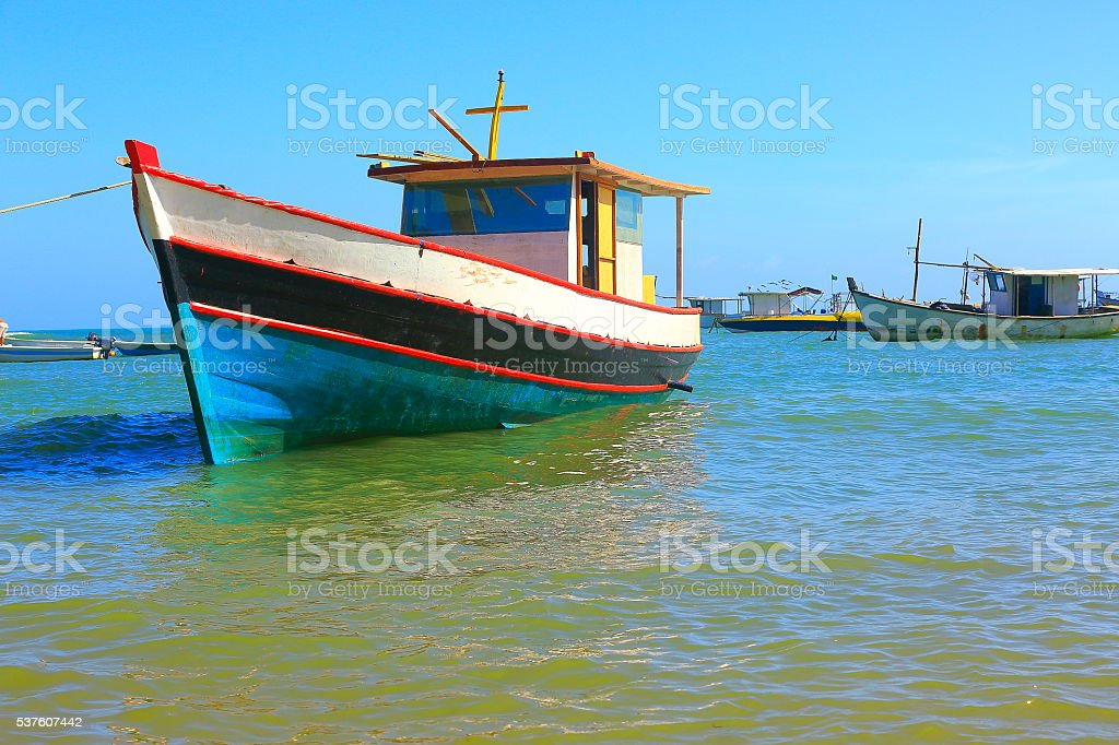 Fishermen rustic wooden boats, Praia do Forte beach, Bahia, Brazil stock photo