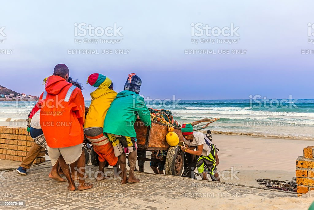 Fishermen seen pulling the trailer up the ramp stock photo