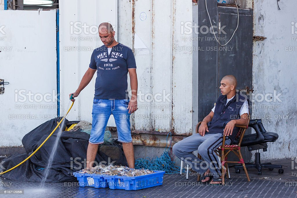Fishermen selling fresh crabs on the waterfront in Yafo, Israel stock photo