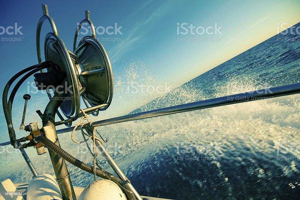 Fishermen Trawler Full Speed on Waves stock photo