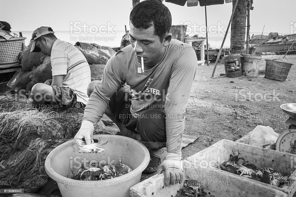 Fishermen was sitting size of crabs for sale stock photo