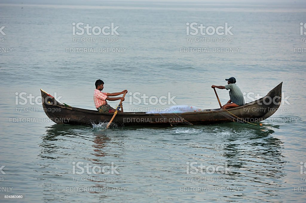 fishermen were catching fish on the canoe stock photo