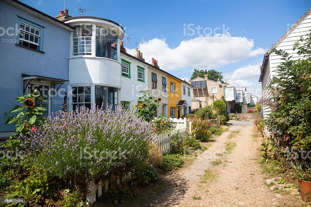 fishermen's cottages on old road in sunny Maldon England stock photo