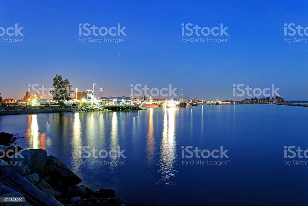 fishermen's harbor at blue hour stock photo