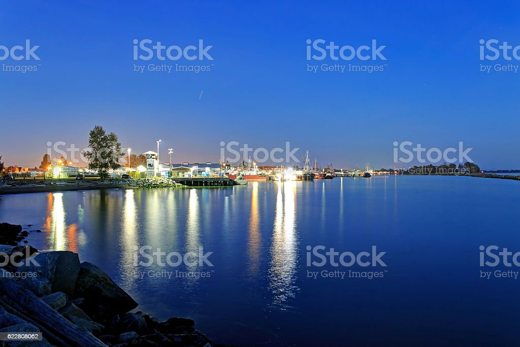 fishermen's harbor at blue hour stock photo