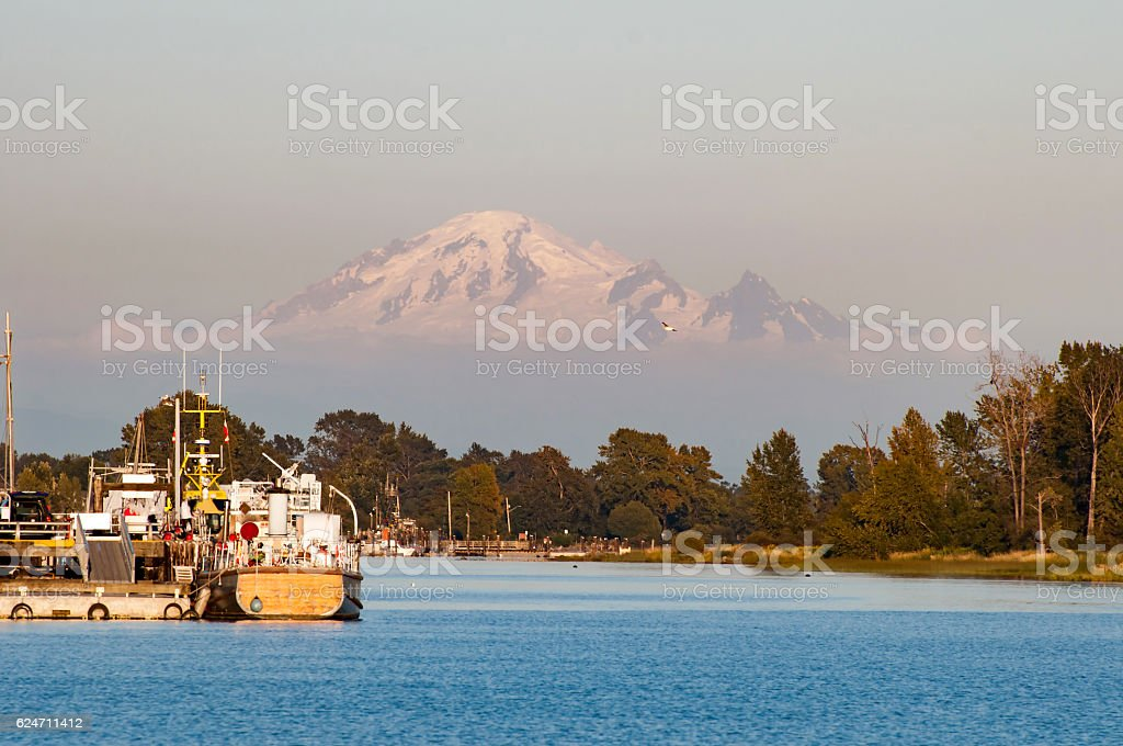 fishermen's harbor with Mt. Baker in the background at sunset stock photo