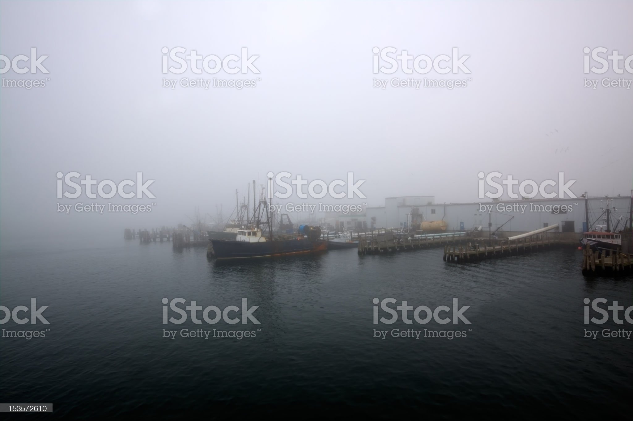 Fishermen's wharf covered in dense morning fog. royalty-free stock photo