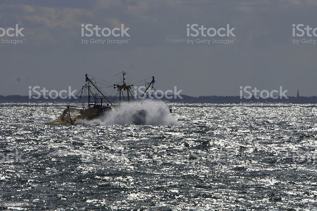 Fishersboat in the Sea stock photo