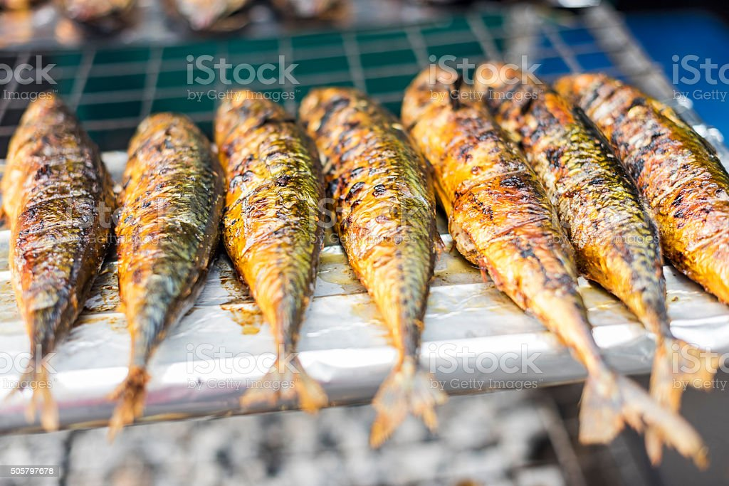 Fishes on BBQ stock photo