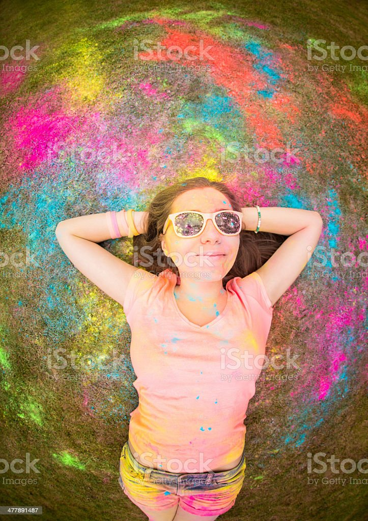 Fisheye image of girl at holi festival with colorful powder royalty-free stock photo