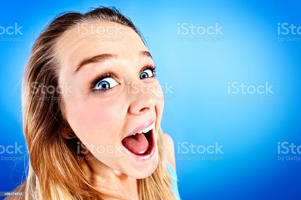 Fish-eye look at pretty blonde teen laughing royalty-free stock photo