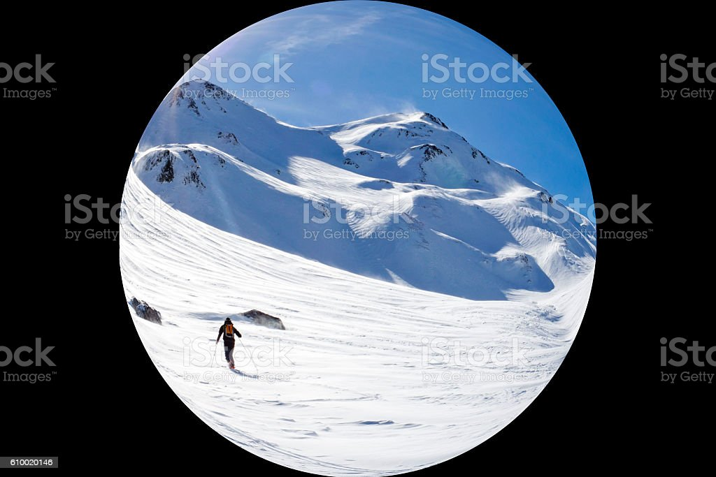 fisheye of skier making turns in a sunny day stock photo