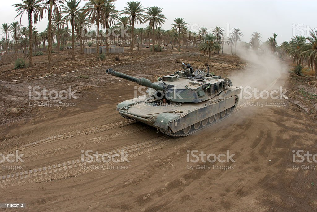 Fisheye style image of a tank driving on a dirt road stock photo