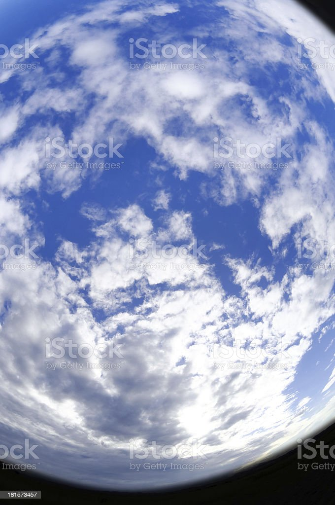 Fisheye view blue sky with white clouds royalty-free stock photo