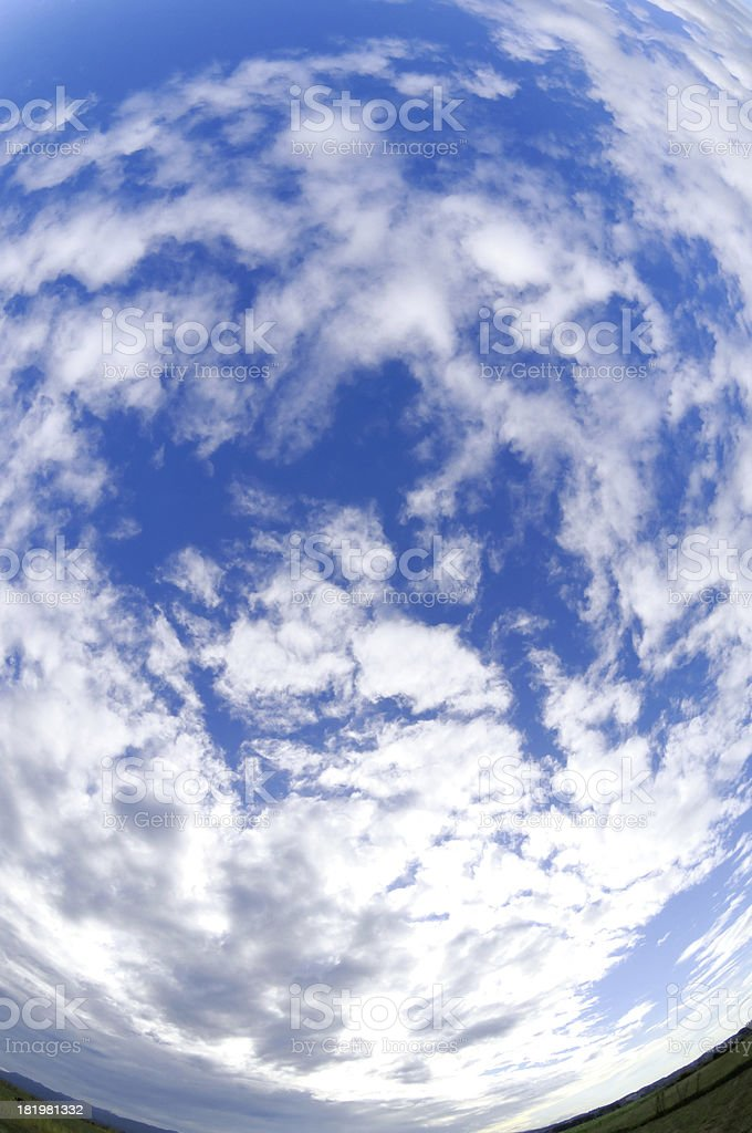 Fisheye view blue sky with white clouds stock photo