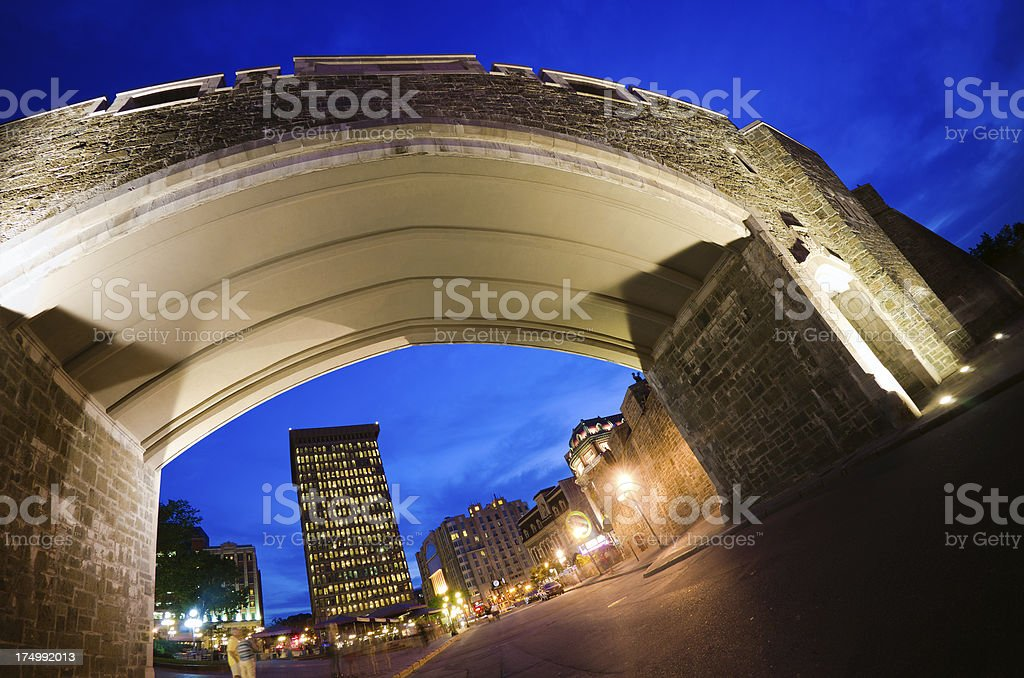 Fisheye view of Porte Saint-Jean in Quebec City at night royalty-free stock photo