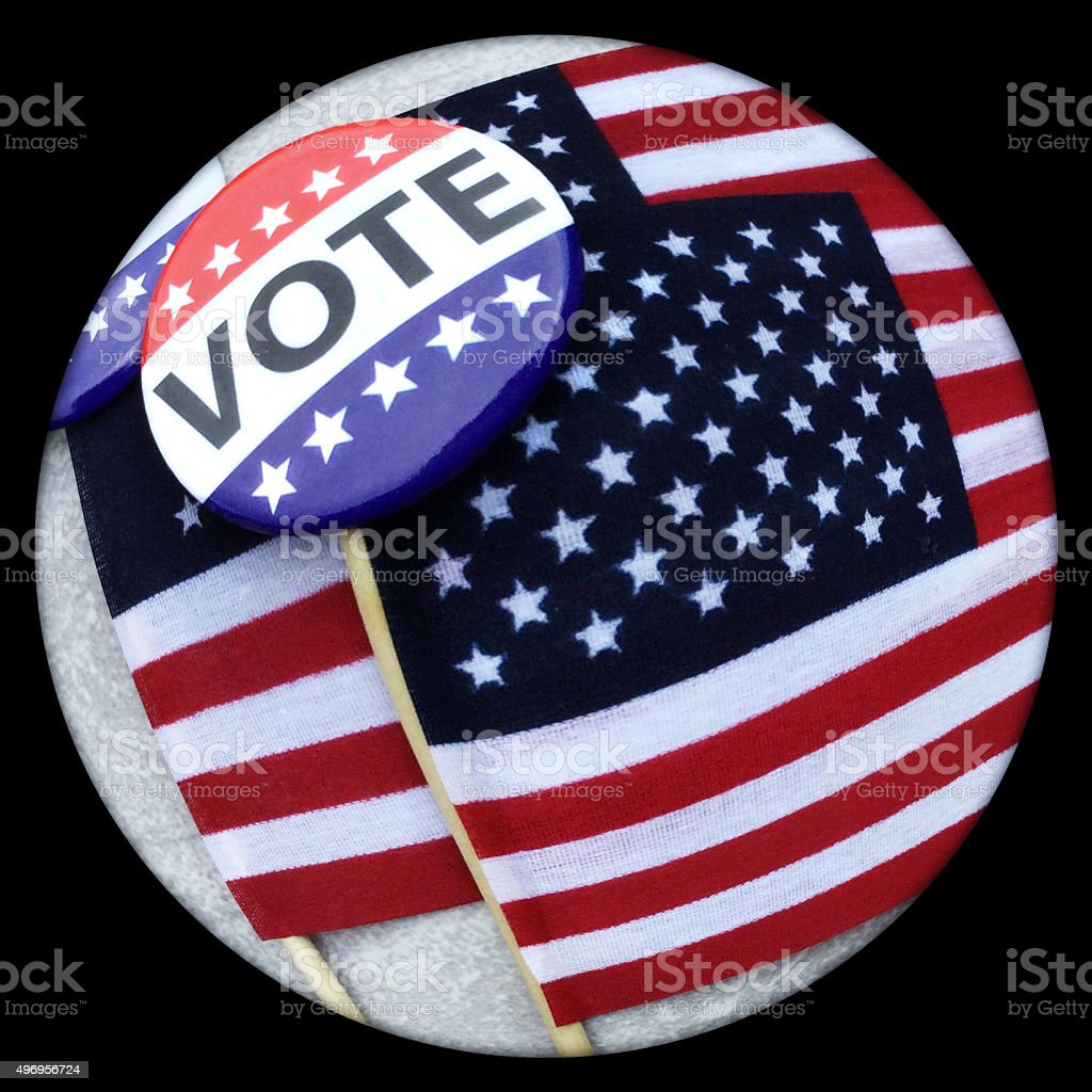 Fisheye view of VOTE campaign button on USA flags. stock photo