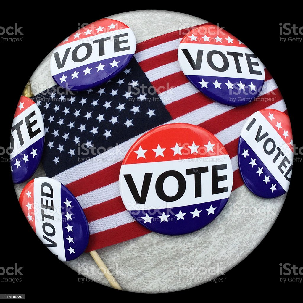 Fisheye view of VOTE campaign buttons on American flag stock photo