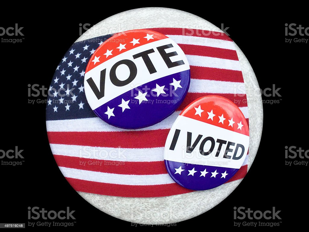 Fisheye view of VOTE campaign buttons on USA flag. stock photo