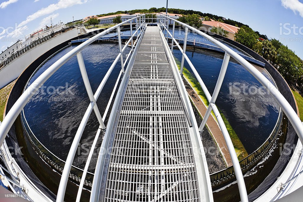 Fish-eye View of Walkway over Wastewater Tank stock photo