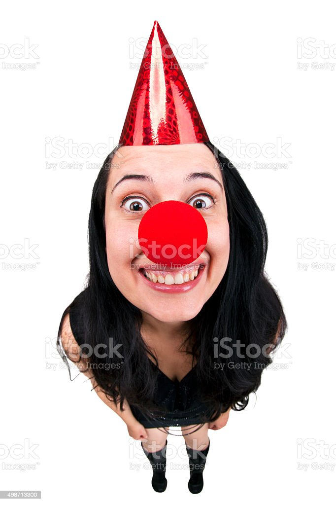 Fisheye woman wearing a party hat and clown nose. stock photo