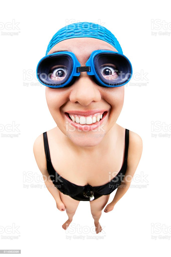 Fisheye woman with swimsuit and swimming goggles stock photo