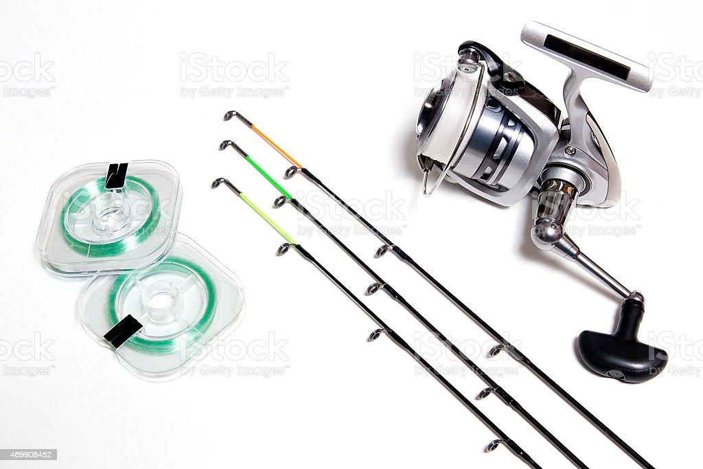 Accesorios de pesca sobre fondo blanco. foto de stock libre de derechos