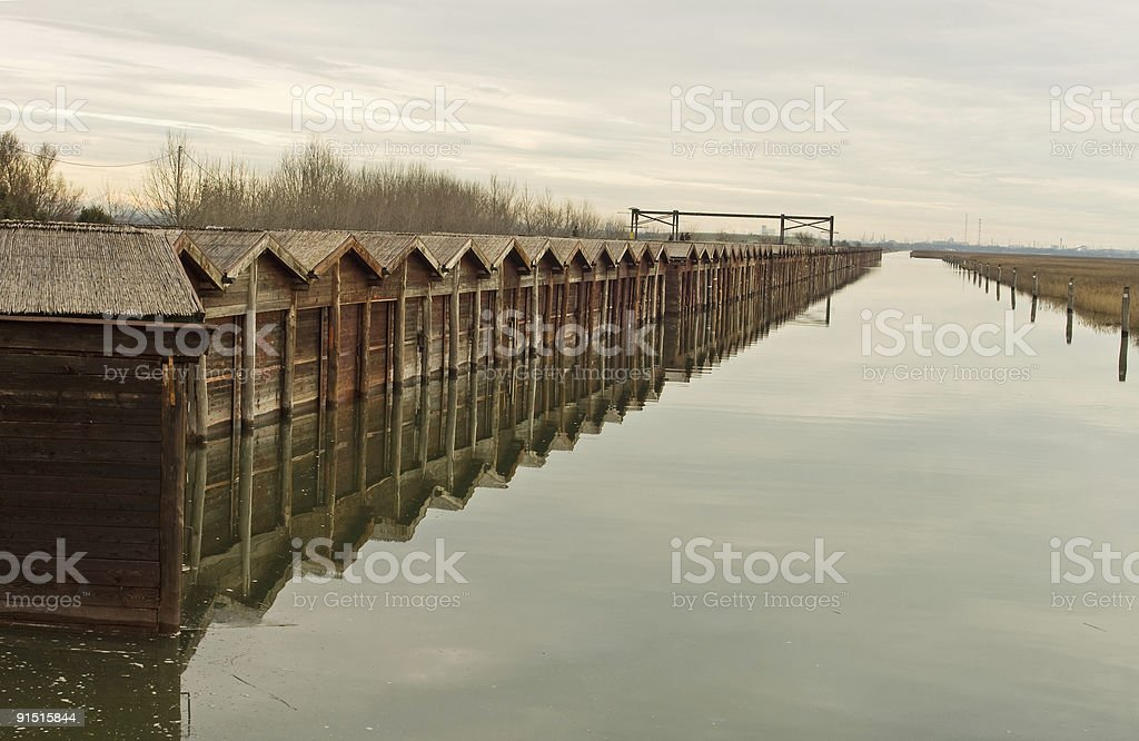 Fishing and hunting huts in Venice lagoon stock photo