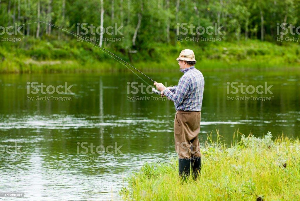 Fishing at a beautiful river royalty-free stock photo