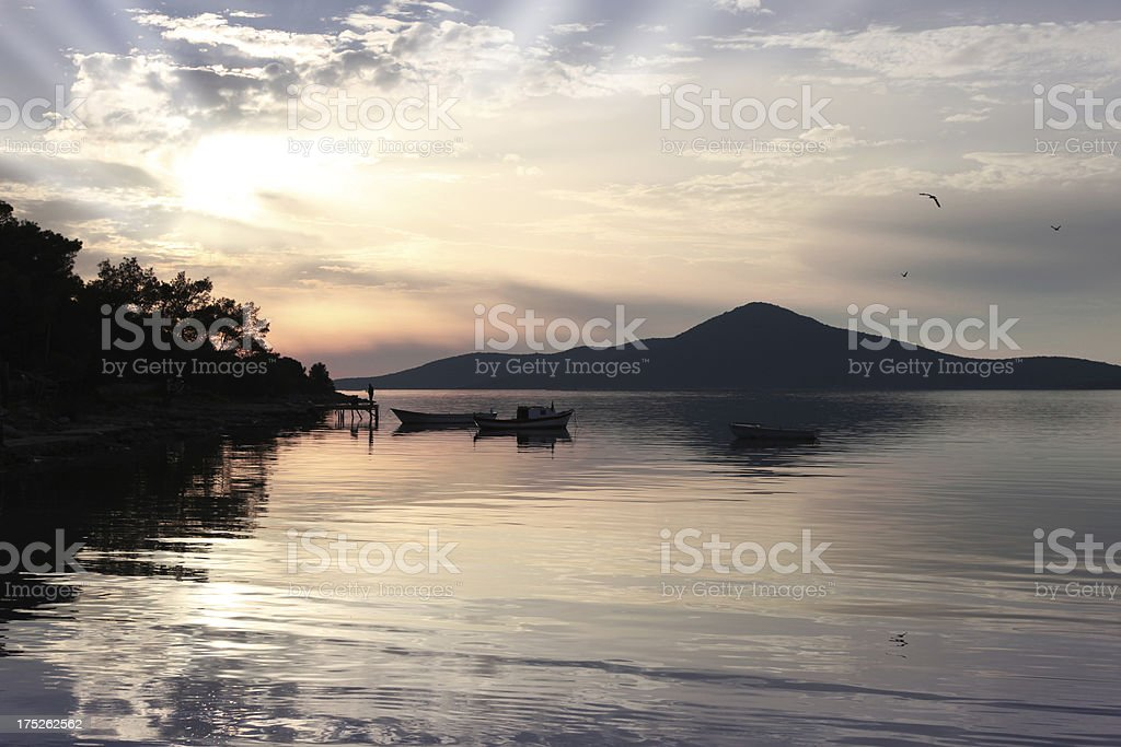 Fishing at beautiful sunset royalty-free stock photo