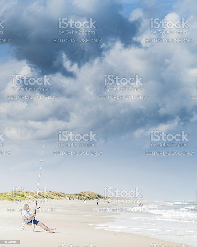 Fishing at Coquina Beach, North Carolina stock photo